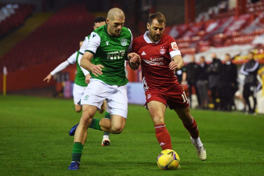 Niall McGinn in action against Hibernian.