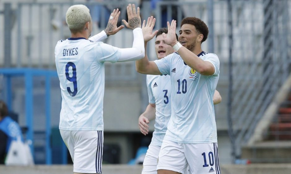 Scotland's Che Adams celebrates making it 1-0 with Lydnon Dykes (left) against Luxembourg.