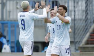 Scotland's Che Adams celebrates making it 1-0 with Lyndon Dykes (left) during the friendly match against Luxembourg.