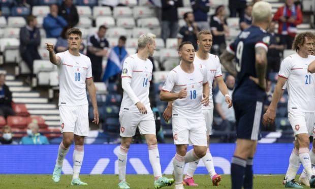 Patrik Schick (L) celebrates his first goal against Scotland.