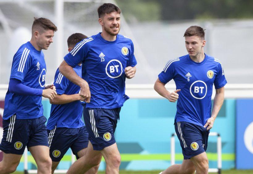 Kieran Tierney (R) remains a doubt for Scotland's trip to Wembley.