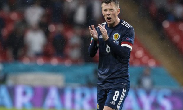 Callum McGregor, a former team-mate of Scott Brown at Celtic, applauds the fans at full-time.