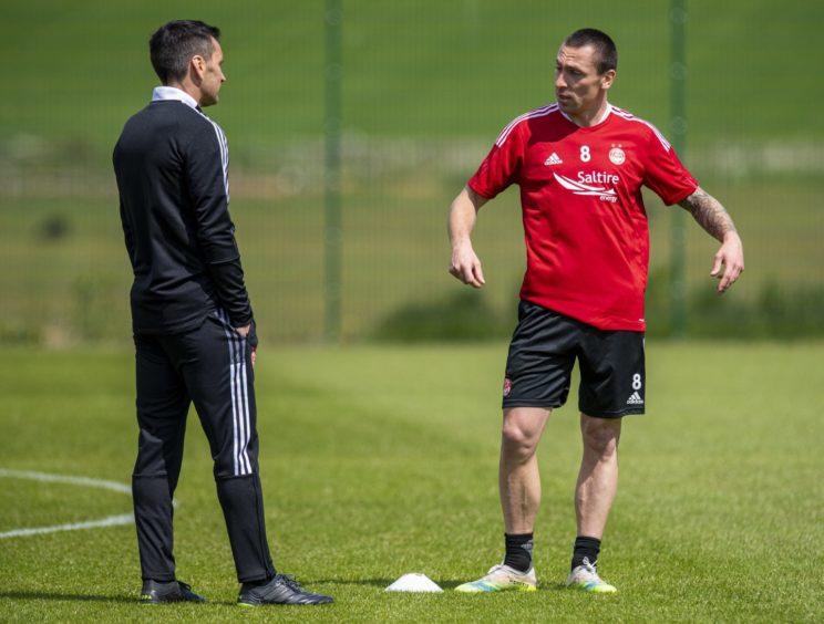 Aberdeen head coach Stephen Glass with Scott Brown.