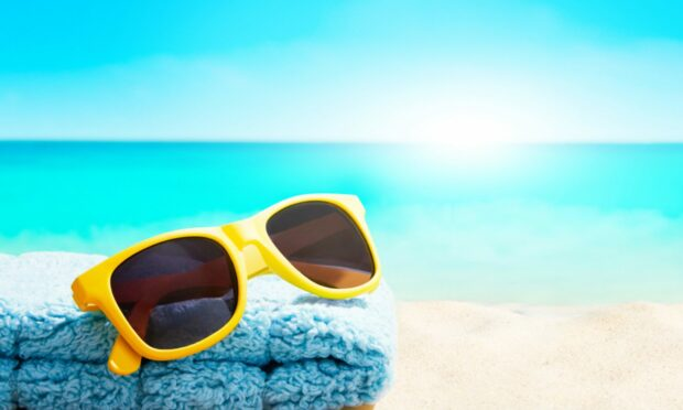 Many Scots spend up to £250 on items including sunglasses before jetting off on holiday.