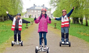 Gayle joins a Segway tour around Haddo Country Park run by Wheelie Fun. Pictured in front of Haddo House is Gayle, centre, flanked by company owners Claire and Merv Christie.