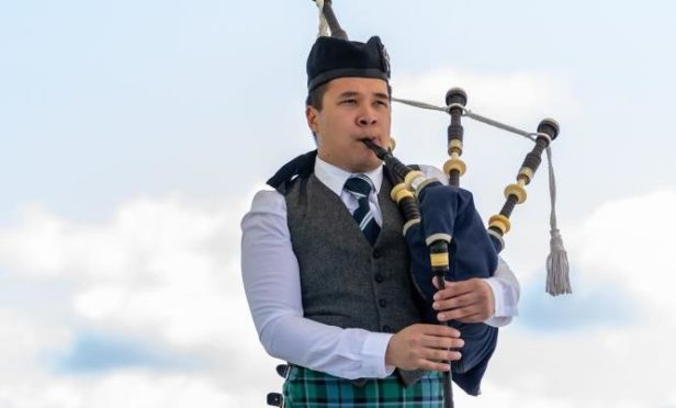 A solo piper competing at the 2019 Aboyne Highland Games