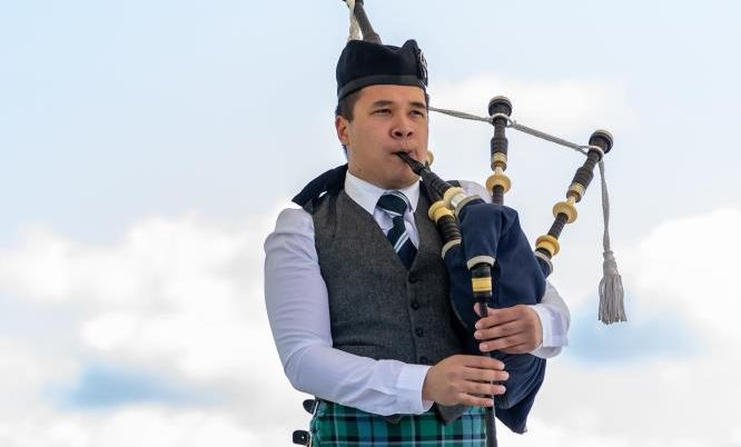 A solo piper competing at the 2019 Aboyne Highland Games.
