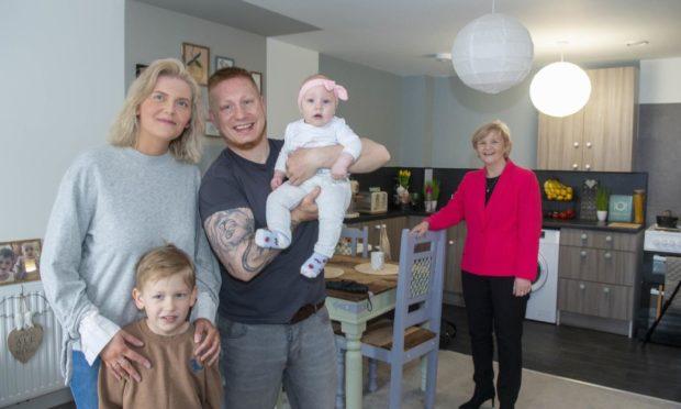 Councillor Jenny Laing with Edyta and Lukasz Kranz and their family who recently moved into the development.