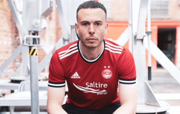 Andy Considine models Aberdeen's new home kit.