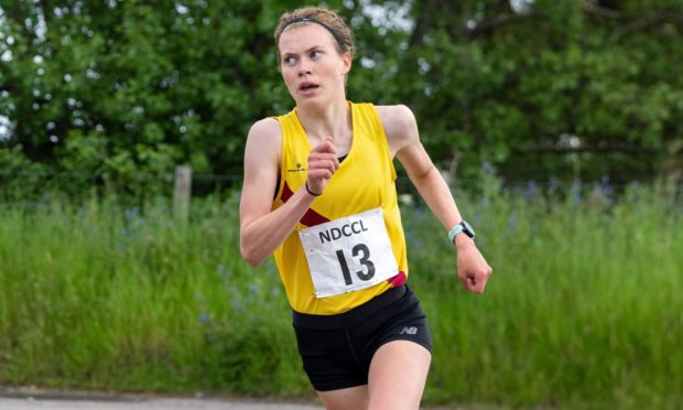 Megan Keith running to victory in the Forres Back to Basics 10K race at the weekend.