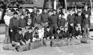 The boys and officers of the 67th Aberdeen (Mastrick Church) Company Boys' Brigade all set to leave Aberdeen for their summer camp in Wales in 1988.