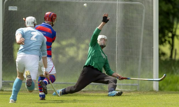 Kingussie's Savio Genini lifts the ball over the Caberfeidh keeper Iain Macall to score.