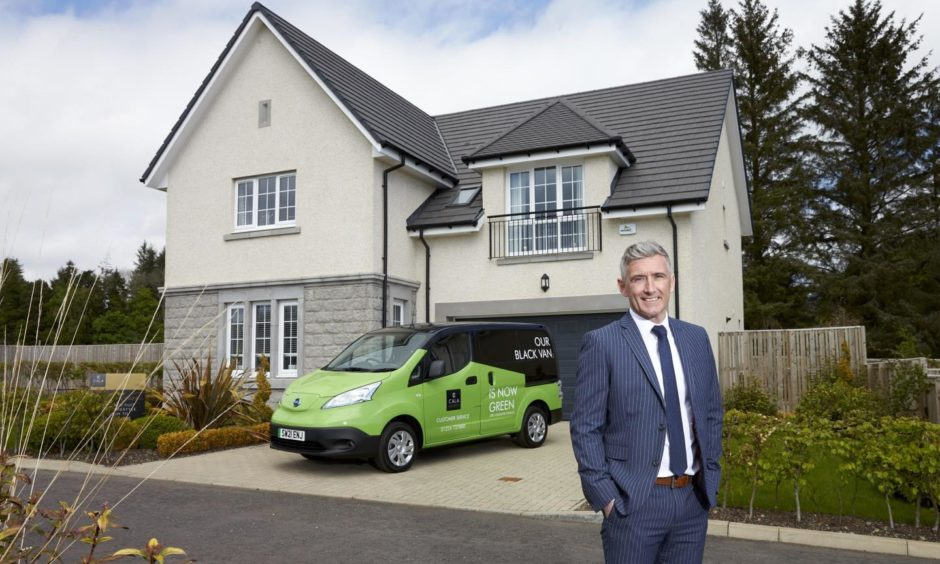 Green for go: Stuart Moggach, head of customer services for CALA Homes' North office, pictured next to one of the company's new 'green vans'.