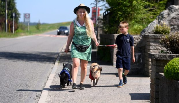 Michelle Barclay-Dunbar from Oyne, her son Brandyn and pet piglets. Picture by Chris Sumner