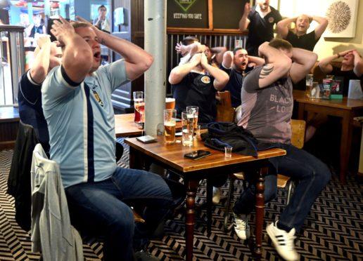 Fans in Old School House, Little Belmont Street, watching Scotland vs Czech Republic.
