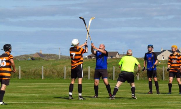 Camanachd Leodhais playing shinty. Picture from Facebook