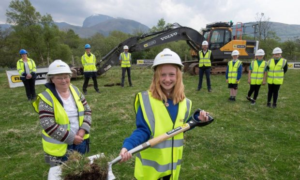 Caol Primary School pupil Isla Ross and Joan Ling of Caol Community Council helped dig the first turf to mark the beginning of work on  the new flood defences.