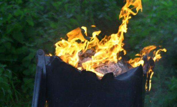 Wheelie bin on fire.