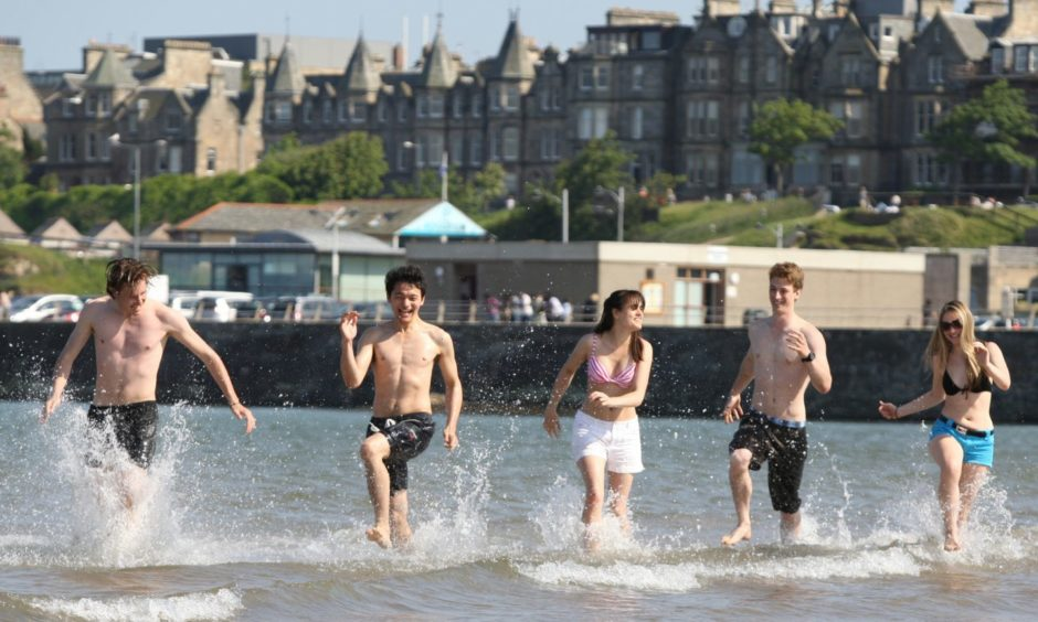 Kris Miller, Courier, 03/06/11. Picture today at West sands, St Andrews shows Andreas Anderson, Rosie Collinge, Martin Kenmore, Anastasiya Shkurko and Fritz Lodge, all students at St Andrews who enjoyed a day at the beach thanks to the unusually warm weather.