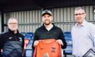 Goalkeeper Robert Donaldson is flanked by new Strathspey Thistle manager Charlie Brown, left, and committee member Ian Anderson.