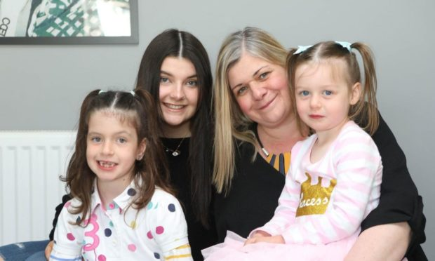 Georgia Bendall and her daughters.