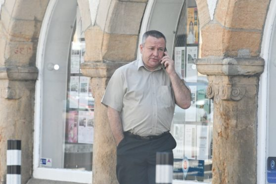 Andrzej Bartoszcyk leaves Elgin Sheriff Court.