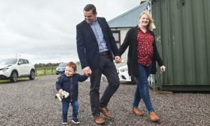 Douglas Ross with his wife Krystle and son Alistair.