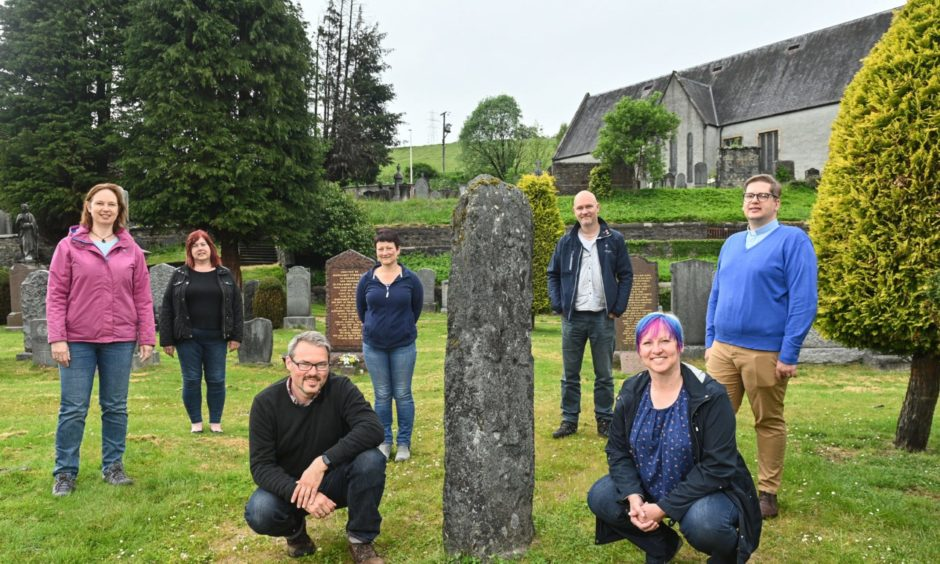 Dufftown and Mortlach Development Trust directors near a Pictish stone hope projects in the town can aid regeneration mission.