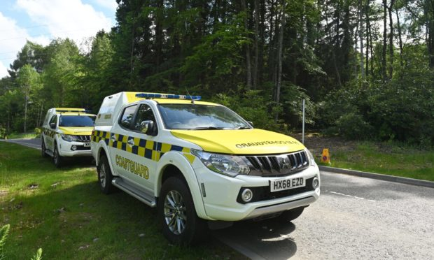 Search team members Pete Crichton and search dog Gem from SARDA Scotland are pictured near Craig Dunain Duck Pond in Inverness in the search for a missing vunerable person. Pictures by JASON HEDGES