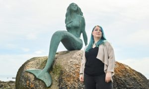 Laura Kirk, pictured here at the popular mermaid sculpture in Balintore, is steeped in the folklore and tradition of the Seaboard villages