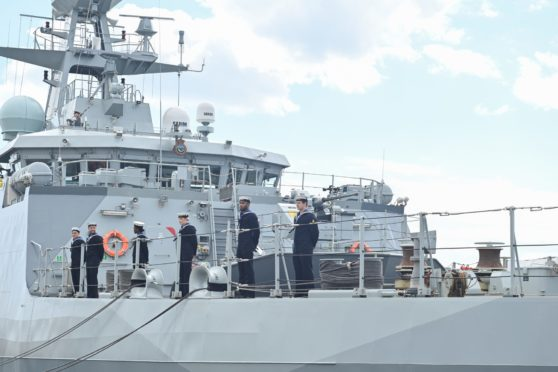 Sailors from the ships 45-strong crew stand on ceremony to celebrate the commissioning of the HMS Spey.