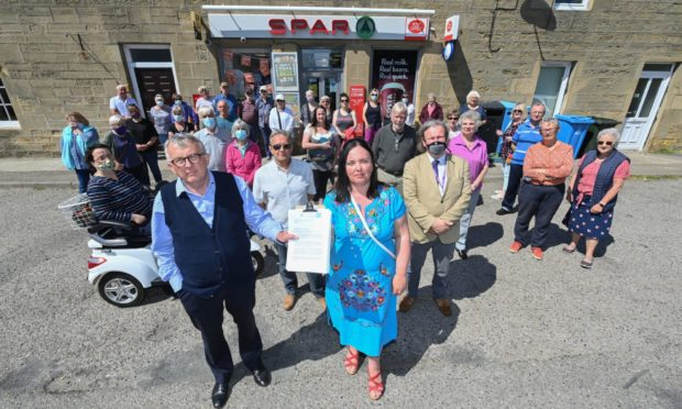 Angry residents gathered outside the Spar and Post office in Balintore prior to the letter being submitted.