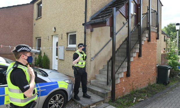 Police at the scene of a sudden death in Inverness