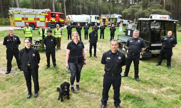 Front L2R - Fiona Robertson (Area Visitor Manager) with dog Harris, Gareth Luce (Watch Commander) and Ewen McIntosh (Watch Commander Rural Support).  Pictures by JASON HEDGES