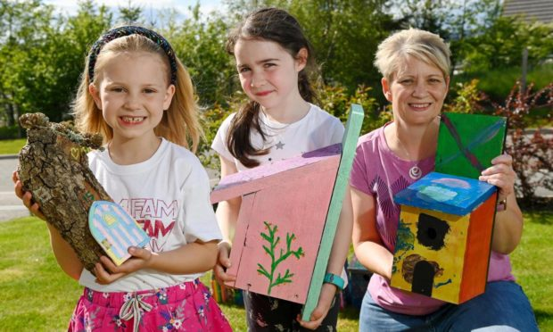 Emily Graham, 7, Abbie Henderson, 6, and Louise Graham with some fairy trail creations