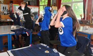 Pupils at Hazlehead Academy in Aberdeen during Scotland's opening Euro 2020 match.