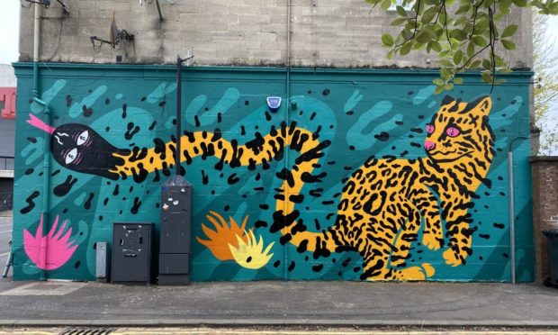 Aberdeen artist KMG - Katie Guthrie - will kick-off this year's Nuart festival with her distinctive street art style.