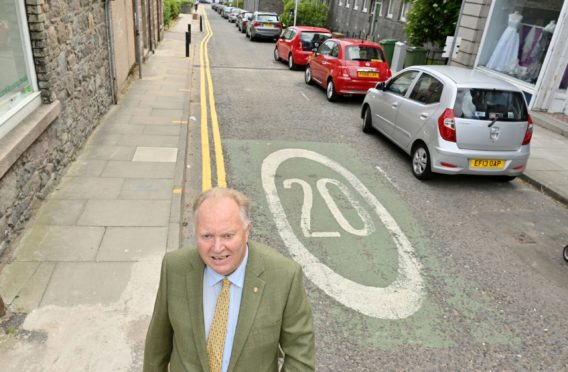 The 20mph speed limit in the Rosemount area, introduced as part of Spaces for People, is planned to be retained on the grounds that it makes the community safer. Pictured is Councillor Bill Cormie at the top of Short Loanings, at the junction with Rosemount Place. Picture by Kami Thomson.