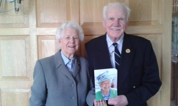 Colonel and Mrs le Gassick with their 60th wedding anniversary card from the Queen.
