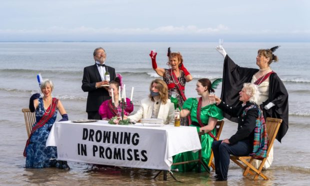The activists set up a table on Findhorn Beach near Forres. Picture by Brian Smith/JasperImage