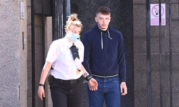 Jay McBain being led away to begin his sentence.