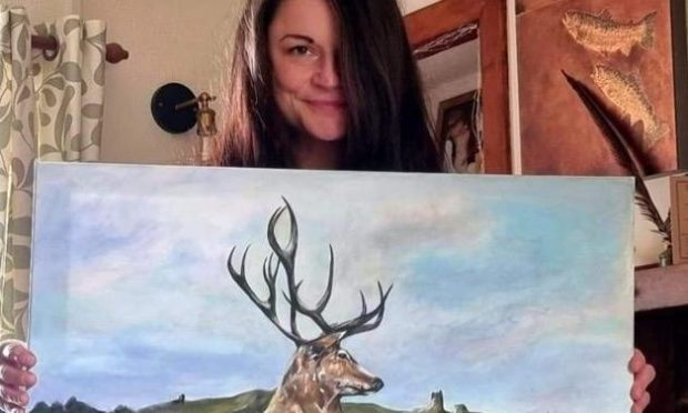 Rachel Thomson with one of her paintings.