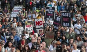 Protesters gathered outside the Scottish Parliament in September to protest lockdown measures and the wearing of face coverings, with some placards referencing Covid conspiracy theories.