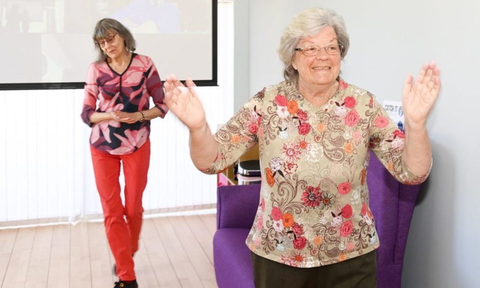 Two elderly women dancing at the Forget Me Not Club