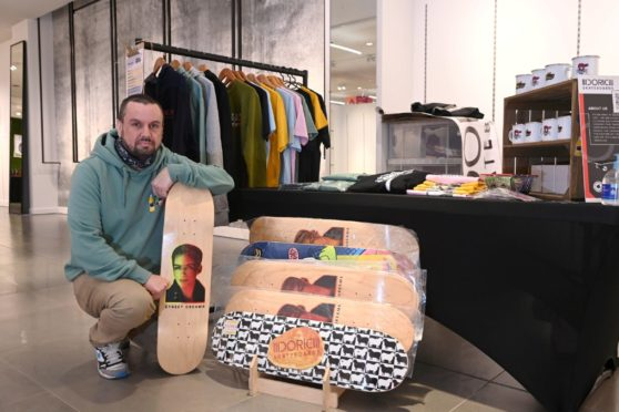 Pictured is Gary Kemp of Doric Skateboards at his stall at Curated Aberdeen, a new market set up inside the Bon Accord Centre.  Picture by Darrell Benns Pictured on 03/06/2021 CR0028702