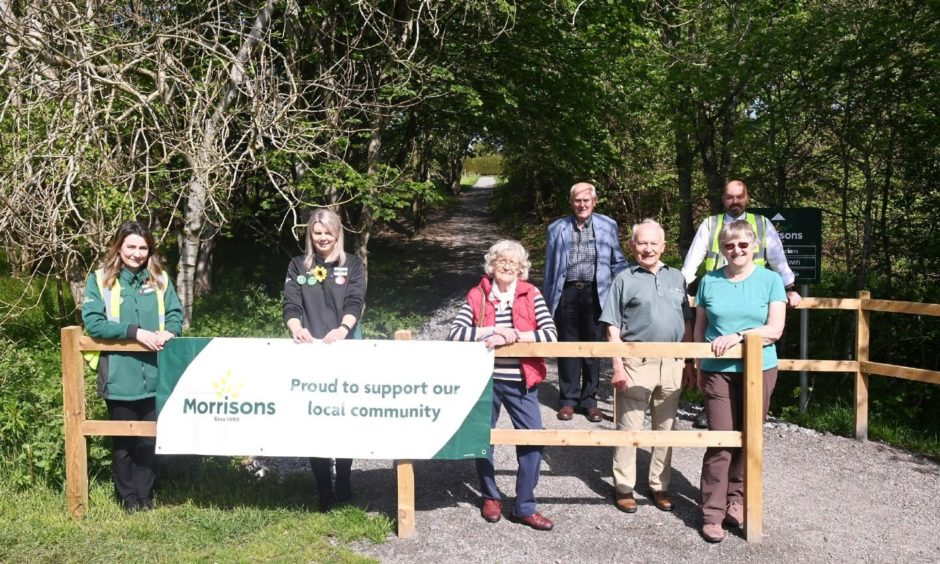 Pictured are from left, Aysha Hutcheon, Laura Brown, Morag Parr, Dick Jennings, David Culshaw, Liz Culshaw and Store Manager Stuart Aitken at the new path from the Deeside Way to Morrisons Supermarket in Banchory.