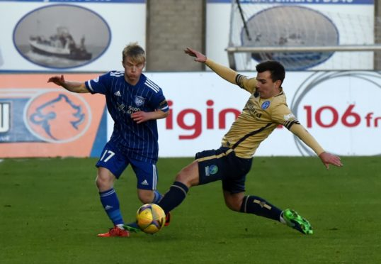 Lyall Cameron takes on Forfar while on loan at Peterhead.