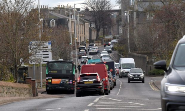 Queues are common place in Berryden Road at the junction with Hutcheon Street - but the council has been allowed to acquire all the land needed to build a new dual carriageway.