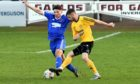 Dylan Mackenzie, right, in action for Nairn County.