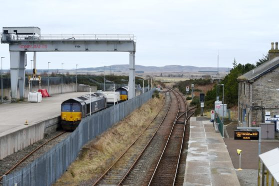 A train of waste nuclear fuel from Dounreay is prepared at the Georgmass railway sidings between Thurso and Wick for its journey south.